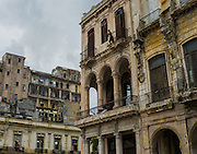 A man stands out on his balcony in Habana Vieja, Cuba.