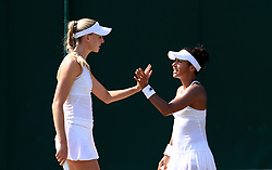 Heather Watson (right) and Naomi Broady during their doubles match against Harriet Dart and Katy Dunne against on day four of the Wimbledon Championships at The All England Lawn Tennis and Croquet Club, Wimbledon.