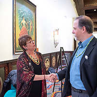 City Councilor Fran Palochak of District 4, left, greets BNSF Railway Economic Development Manager Peiter Hjertstedt, right, during the dinner celebrating McKinley County Day in Santa Fe Thursday.
