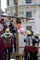 "© Licensed to London News Pictures. 19/04/2019. LONDON, UK.  Members of The Wintershall Players present their traditional ""The Passion of Jesus"" play in Trafalgar Square on Good Friday in front of huge crowds.  The play brings to life the events leading to the crucifixion of Jesus Christ, played by James Burke-Dunsmore (pictured), and his subsequent resurrection.  Photo credit: Stephen Chung/LNP"