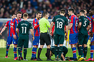 Tensions running high among the players and Peter Bankes (Referee) attempting to resolve their concerns during the Premier League match between Crystal Palace and Newcastle United at Selhurst Park, London, England on 22 February 2020.