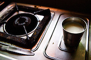 A leftover cup of chai tea sits on the kitchen stove at Astitva. The kitchen at the non-profit association is operated as a business by two of the organization's clients. Astitva, a non-governmental organization (NG)) in Debradun, India, helps battered women become more economically independent, such as starting small businesses. It also provides the women with family services so they have time to pursue their business interests. Dehradun is a city of 575,000 about six hours north of New Delhi by train. Nestled next to the Himalayan foothills, it's a little off the path for most tourists. Astitva is located in a neighborhood where poor and upper class people live within close proximity.