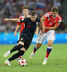 SOCHI, July 7, 2018  Roman Zobnin (R) of Russia vies with Ante Rebic of Croatia during the 2018 FIFA World Cup quarter-final match between Russia and Croatia in Sochi, Russia, July 7, 2018. (Credit Image: © Yang Lei/Xinhua via ZUMA Wire)