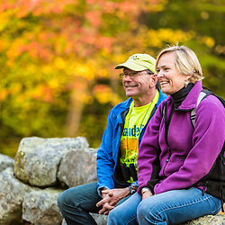 A couple enjoys a fall day in Barrington, New Hampshire.