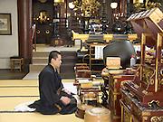 Buddhist priest praying in temple Asakusa Tokyo