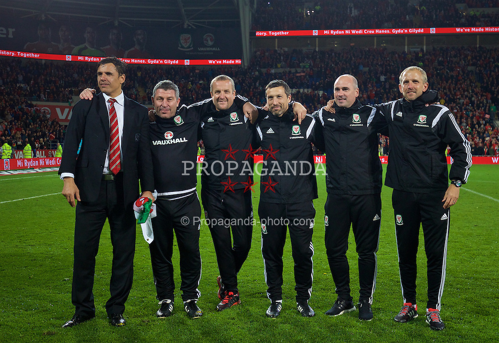 CARDIFF, WALES - Tuesday, October 13, 2015: Wales' manager Chris Coleman, assistant manager Osian Roberts, goalkeeping coach Martyn Margetson, head of fitness and science Ryland Morgans, sport psychologist Ian Mitchall, coach Paul Trollope celebrate on the pitch following the 2-0 victory over Andorra and qualification for the UEFA Euro 2016 finals after the final qualifying Group B match at the Cardiff City Stadium. (Pic by David Rawcliffe/Propaganda)