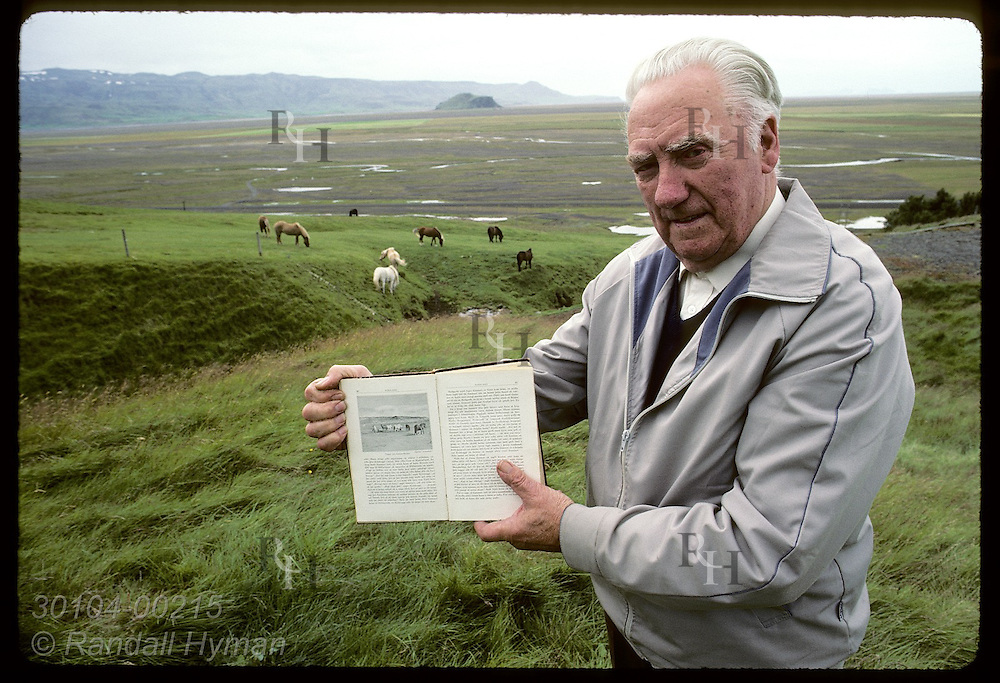 Man shows how a drawing in Njall's Saga of historic pastures at Hlidarendi matches real scene. Iceland