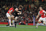 Michael Phillips of Wales puts in a hit on Sam Whitelock of the Allblacks. Invesco Perpetual match, Wales v New Zealand at the Millennium stadium in Cardiff on Sat 27th Nov 2010.  pic by Andrew Orchard, Andrew Orchard sports photography,