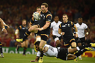 George North of Wales breaks past the tackle from Fiji's Metuisela Talebula.  Rugby World Cup 2015 pool A match, Wales v Fiji at the Millennium Stadium in Cardiff, South Wales  on Thursday 1st October 2015.<br /> pic by  Andrew Orchard, Andrew Orchard sports photography.