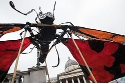 London, UK. 4th September, 2021. Extinction Rebellion climate activists manoeuvre a large insect puppet in Trafalgar Square before a colourful March for Nature on the final day of their two-week Impossible Rebellion. Extinction Rebellion are calling on the UK government to cease all new fossil fuel investment with immediate effect.