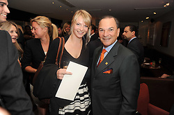 A party to promte the exclusive Puntacana Resort & Club - the Caribbean's Premier Golf & Beach Resort Destination, was held at The Groucho Club, 45 Dean Street London on 12th May 2010.<br /> <br /> Picture shows:-Left to right, TANYA HAMILTON-SMITH and FRANK RAINIERI