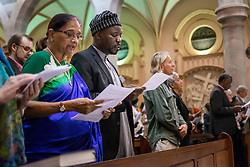 Participants sing during a July 19 interfaith prayer service, held at the Roman Catholic Emmanuel Cathedral in Durban, South Africa, during the 2016 International AIDS Conference.