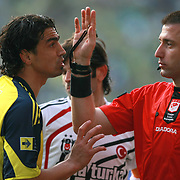 Referee's Huseyin GOCEK (R) and Fenerbahce's Mehmet TOPUZ (L) during their Turkish superleague soccer derby match Fenerbahce between Besiktas at Sukru Saracaoglu stadium in Istanbul Turkey on Sunday 18 April 2010. Photo by TURKPIX