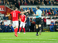 Football - 2016 / 2017 World Cup Qualifier - Group D: Wales vs. Serbia<br /> <br /> Gareth Bale  of Wales protests to referee Alberto Undiano Mallenco, at Cardiff City Stadium.<br /> <br /> COLORSPORT/WINSTON BYNORTH