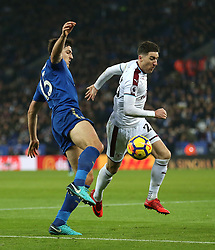 Leicester City's Harry Maguire (left) and Burnley's Stephen Ward battle for the ball