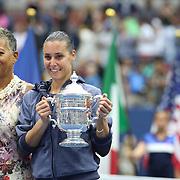 Winner Flavia Pennetta, (right), Italy, with the winning trophy after the Women's Singles Final match during the US Open Tennis Tournament, Flushing, New York, USA. 12th September 2015. Photo Tim Clayton