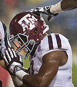 Texas A&M runninf back Trey Williams (3) reacts after scoring a touch down NCAA college football game against the Arkansas Razorbacks in Fayetteville, Ark., Saturday, Sept. 28, 2013. Texas A&M defeated Arkansas 45-33. (AP Photo/Beth Hall)