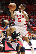 Utah guard Kareem Storey (5) is fouled by Cal State Fullerton guard Kwame Vaughn (5) is he attempts to score during the first half of an NCAA college basketball game in Salt Lake City, Wednesday, Dec. 7, 2011. (AP Photo/Colin E Braley)