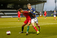 Rafael Brito holds off Connor Smith (C)(Heart of Midlothian) during the U17 European Championships match between Portugal and Scotland at Simple Digital Arena, Paisley, Scotland on 20 March 2019.
