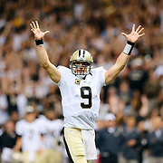 New Orleans Saints quarterback Drew Brees (9) celebrates a touchdown during the NFL regular season game against the Atlanta Falcons on Thursday, Oct. 15, 2015 in New Orleans. The Saints won, 31-21. (Ric Tapia via AP)