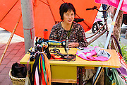 China, Xian, seamstress at an outdoor street market
