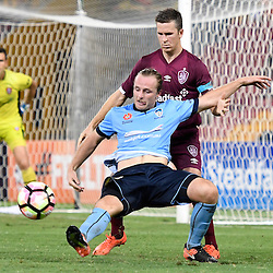 BRISBANE, AUSTRALIA - FEBRUARY 3: Rhyan Grant of Sydney and Matt McKay of the Roar in action during the round 18 Hyundai A-League match between the Brisbane Roar and Sydney FC at Suncorp Stadium on February 3, 2017 in Brisbane, Australia. (Photo by Patrick Kearney/Brisbane Roar)
