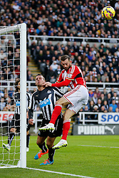 Steven Taylor of Newcastle United collides with the post cutting his head after he heads clear from Steven Fletcher of Sunderland - Photo mandatory by-line: Rogan Thomson/JMP - 07966 386802 - 21/12/2014 - SPORT - FOOTBALL - Newcastle upon Tyne, England - St James' Park - Newcastle United v Sunderland - Tyne-Wear derby - Barclays Premier League.