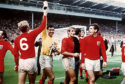 (L-R) England captain Bobby Moore tries to retrieve the Jules Rimet trophy from goalkeeper Gordon Banks, watched by teammates Roger Hunt and Martin Peters