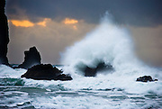 """The pounding Pacific Ocean has eroded these sea stack rocks from bluffs at Cannon Beach, Oregon. Published in """"Light Travel: Photography on the Go"""" book by Tom Dempsey 2009, 2010."""