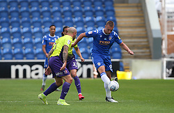 Luke Norris of Colchester United passes the ball under pressure - Mandatory by-line: Arron Gent/JMP - 18/06/2020 - FOOTBALL - JobServe Community Stadium - Colchester, England - Colchester United v Exeter City - Sky Bet League Two Play-off 1st Leg