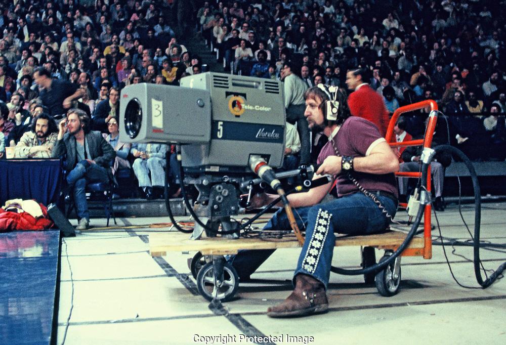 Washington, DC 1974/04/01 Televison cameraman at a basketball game .<br />Photo by Dennis Brack