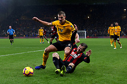 Wolverhampton Wanderers' Ryan Bennett and Bournemouth's Ryan Fraser battle for the ball during the Premier League match at Molineux, Wolverhampton.