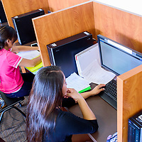 Rey Grey, right, and Shiana Chee work on their english portfolios for Lobo Academy at the TRIO computer lab at the University of New Mexico Gallup Wednesday.