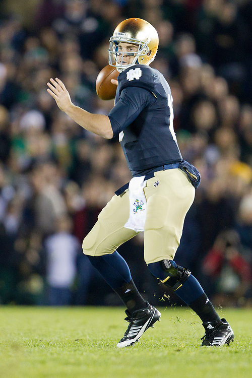 Notre Dame quarterback Dayne Crist (#10) throws pass during third quarter of NCAA football game between Notre Dame and USC.  The USC Trojans defeated the Notre Dame Fighting Irish 31-17 in game at Notre Dame Stadium in South Bend, Indiana.