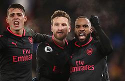 Alexandre Lacazette (right) celebrates setting up Alexis Sanchez's goal during the Premier League match at Selhurst Park, London.