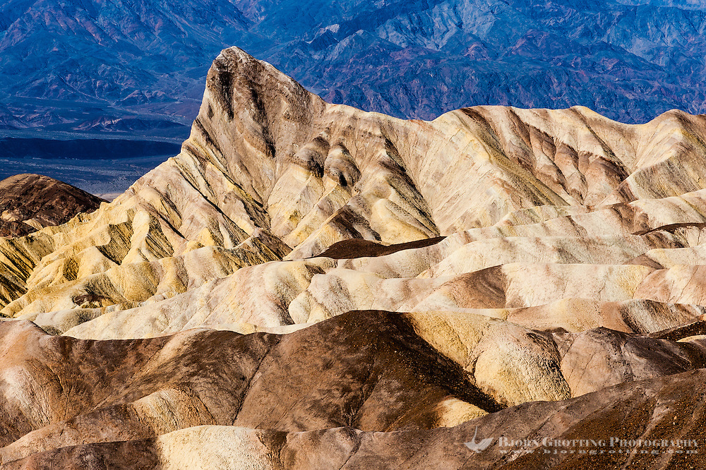 United States, California, Death Valley. Zabriskie Point is a part of Amargosa Range located in east of Death Valley, noted for its erosional landscape. View of Manly Beacon.
