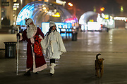 People wearing Christmas themed outfit are seen walking around the nearly empty capital city of Armenia, Yerevan on Friday, Jan 1, 2021. (Photo/ Vudi Xhymshiti)