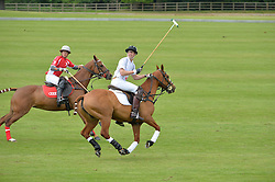 HRH THE DUKE OF CAMBRIDGE (number 4) playing polo at the Audi Polo Challenge at Coworth Park, Blacknest Road, Ascot, Berkshire on 31st May 2015.