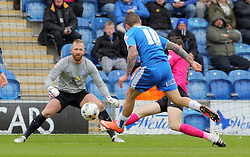 Ben Alnwick of Peterborough United faces a shot from George Moncur of Colchester United - Mandatory by-line: Joe Dent/JMP - 16/04/2016 - FOOTBALL - Weston Homes Community Stadium - Colchester, England - Colchester United v Peterborough United - Sky Bet League One