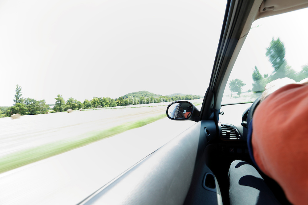 driving with a car along a green recreation road