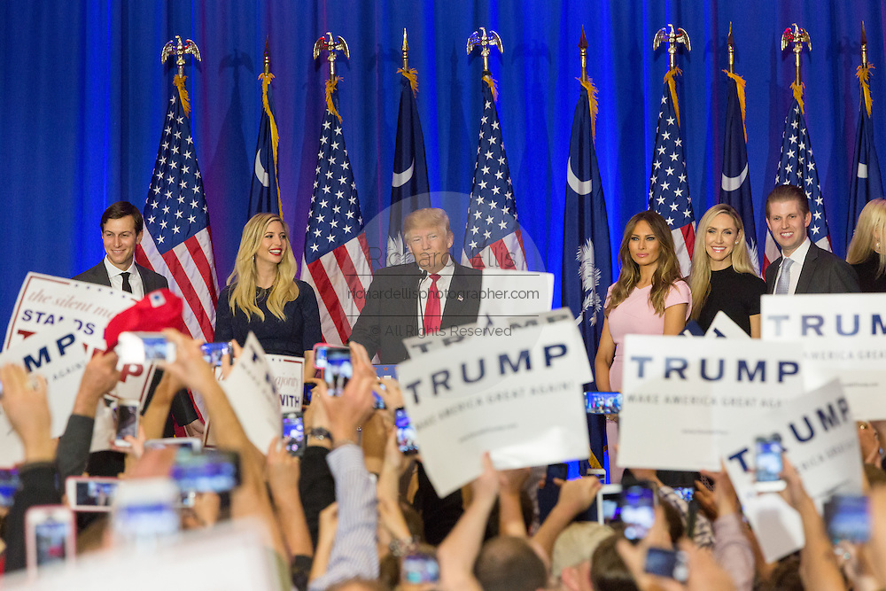 Billionaire and GOP presidential candidate Donald Trump acknowledges cheering supporters along with his family as they celebrate victory in the South Carolina Republican primary February 20, 2016 in Spartanburg, South Carolina, USA .