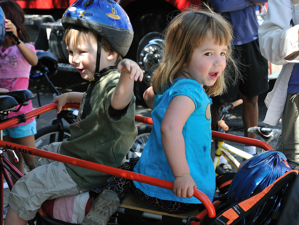 Happy toddler duo hitching a ride on an adult bike during Cyclovia Tucson 2011. Bike-tography by Martha Retallick.