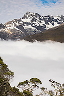 Mountain peak rising above the clouds, Routeburn Track, South Island, New Zealand