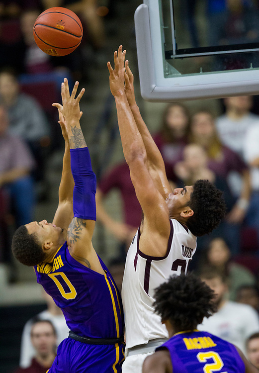LSU guard Brandon Sampson (0) shoots over Texas A&M center Tyler Davis (34) during the first half of an NCAA college basketball game Saturday, Jan. 6, 2018, in College Station, Texas. (AP Photo/Sam Craft)