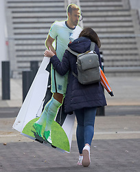 © Licensed to London News Pictures. 08/07/2021. London, UK. A woman is seen carrying a cardboard cutout of England Striker Harry Kane outside Wembley Stadium, the morning after England beat Denmark in the Euro 2020 semi final, to reach their first final since 1966. Photo credit: Ben Cawthra/LNP