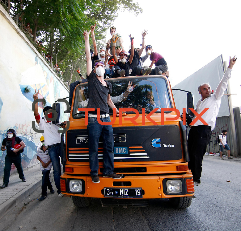 Protestors occupy a truck during a clash at Taksim Square in Istanbul, Turkey, 11 June 2013. Photo by AYKUT AKICI/TURKPIX