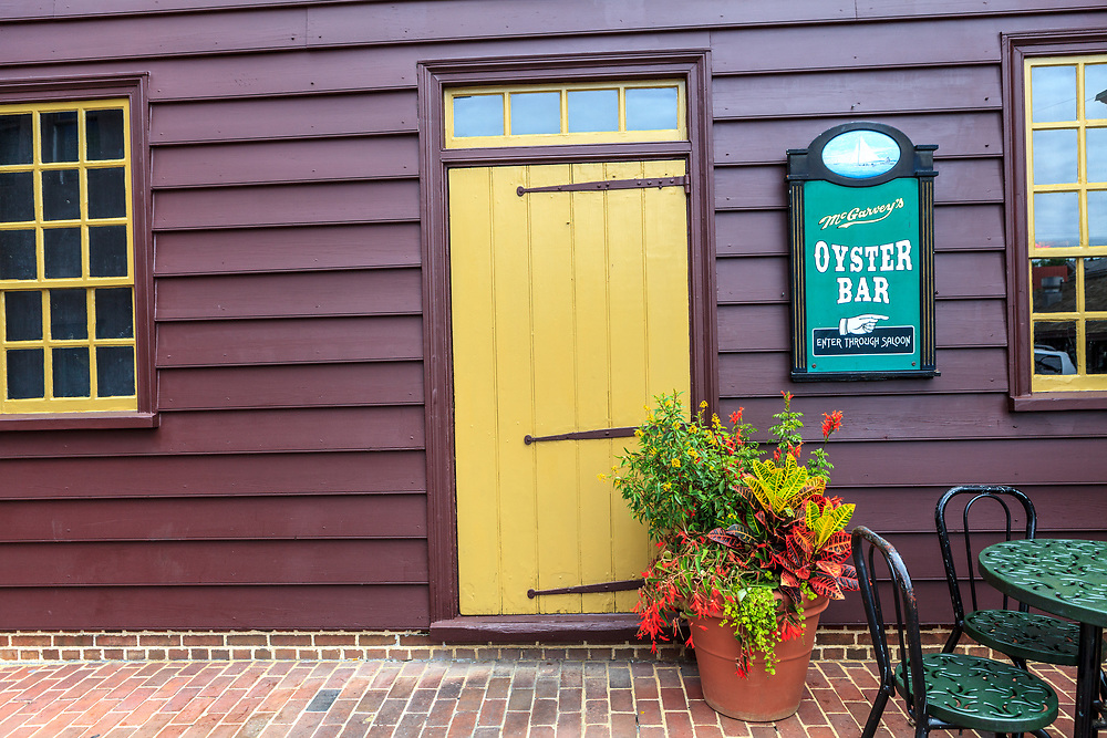 Annapolis, MD, USA - May 20, 2012: A bright yellow door stands out in the Annapolis Maryland business district.