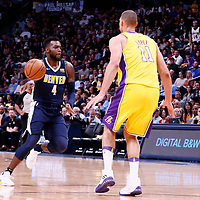 09 March 2018: Denver Nuggets forward Paul Millsap (4) passes the ball past Los Angeles Lakers center Brook Lopez (11) during the Denver Nuggets125-116 victory over the Los Angeles Lakers, at the Pepsi Center, Denver, Colorado, USA.