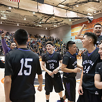 Miyamura Patriots players meet at center court in celebration of their victory during the 4A -District Tournament Championship game at Gallup High School Saturday. The Patriots won 68-63 in OT.