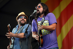 04 May 2012. New Orleans, Louisiana,  USA. .New Orleans Jazz and Heritage Festival. .L/R Coy Bowles and Clay Cook of the Zac Brown Band..Photo; Charlie Varley.